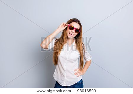 Attractive Young Lady With Long Blond Hair Is So Flirty And Playful. In Pink Trendy Sunglasses, Posi