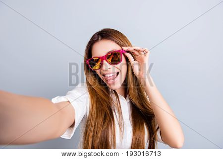 Selfie Mania! Funky Mood. Attractive Young Lady Is Making A Selfie On The Camera, Flirty And Playful