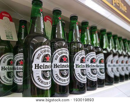 Nowy Sacz Poland - June 25 2017: Heineken Beer on store shelves for sale in a Tesco Hypermarket. Heineken is famous Dutch brewing company.