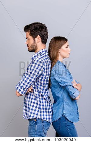 Mistrust And Cheat Problems. Annoyed Couple Is Ignoring Each Other, Standing Back To Back, Wearing C
