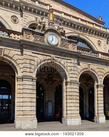 Zurich, Switzerland - 18 June, 2017: part of the facade of the building of the Zurich main railway station. The building of the Zurich main railway station was designed by architect Jakob Friedrich Wanner.