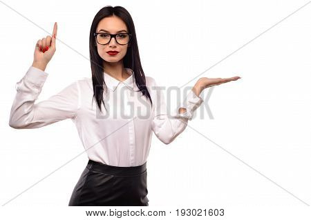 Business woman in glasses presenting isolated on white background.