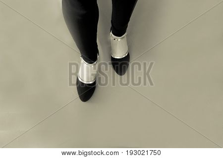 Woman dancing with black salsa shoes. Black and white