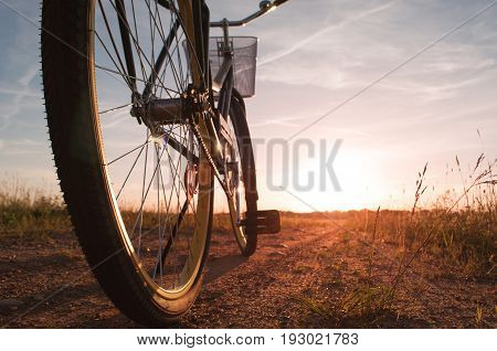 bike on the bandwagon on the road during sunset, view from below rear bike