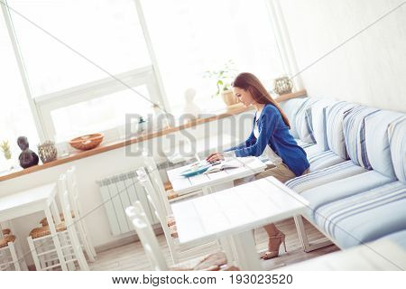 Work Place In A Cafe. Side Profile Full Size Photo Of Young Freelancer, Who Is Working In Relaxing L