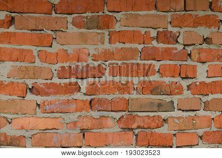 Inaccurate brickwork. Brick wall made of red ceramic brick.