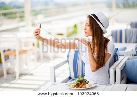 Selfie Mania! So Girlish! Profile Side Photo Of Young Girl, Having Salad On A Summer Open Air Light