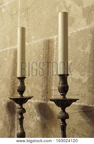 Old medieval candelabrum with wax candles detail of lighting instrument