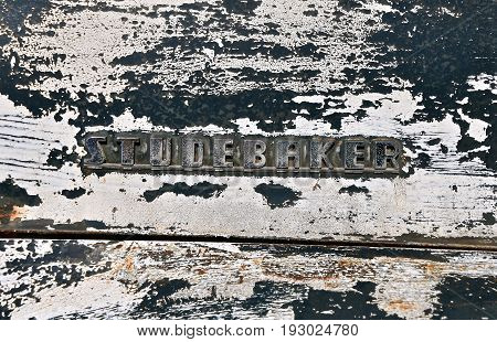 ISABEL, SOUTH DAKOTA, June 23, 2017: The fchrome logo on the hood of an of an old  STUDEBAKER pickup  is a product of the American manufacturer Studebaker Brothers Manufacturing Company based in South Bend, Indiana, founded in 1852 and incorporated in 186