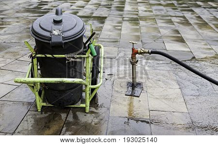 Water hose to clean the streets detail of care and urban cleaning