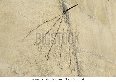 Old Sundial On A Wall