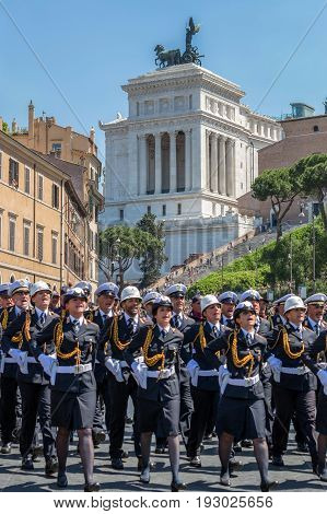 ROME ITALY - JUNE 2 2017: Military parade at Italian National Day. Soldiers in formation including women.The Monument a Vittorio Emanuele II in background.