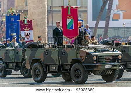 ROME ITALY - JUNE 2 2017: Military and administrative people representing of Italian Regions participating at military parade of Italian National Day with flags and military autos.