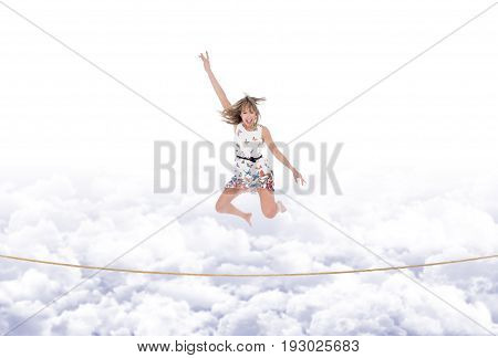 Girl Jumps On The Rope Taut In The Sky
