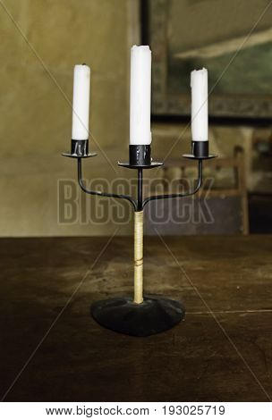 Old Medieval Candelabrum With Wax Candles