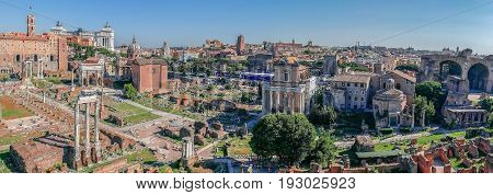 ROME ITALY - MAY 31 2017: Panoramic view over the ruins of the Roman Forum with the Monument Nazional a Vittorio Emanuele II in the background. Rome Italy.