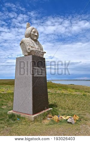 MOBRIDGE, SOUTH DAKOTA, JUNE 24, 2017: The burial site and monument of the Indian Chieftain, Sitting Bull is found on the banks of the Missouri River near Mobridge, South Dakota