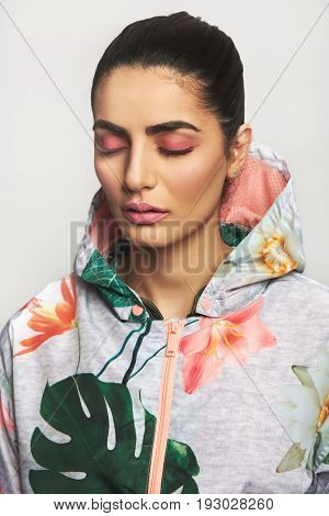Thoughtful Woman With Eyes Closed And Bright Clothes