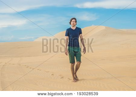 A Man Is Walking In The Desert Vietnam, Mui Ne