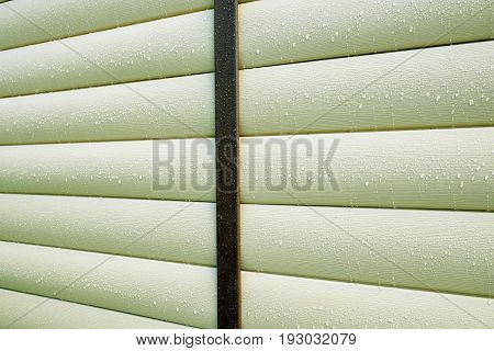 Building wall finished with beige siding panels protect house from bad weather conditions horizontal photo