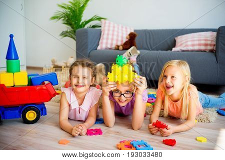 A portrait of three girls in daycare