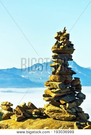 Troll - hillock of stones on the mountain Tromso, Norway
