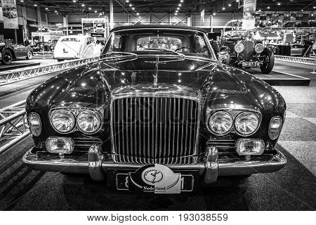 MAASTRICHT NETHERLANDS - JANUARY 14 2016: Full-size luxury car Bentley T1 Drophead Coupe 1970. Coachwork by Mulliner Park Ward. Black and white. International Exhibition InterClassics & Topmobiel 2016