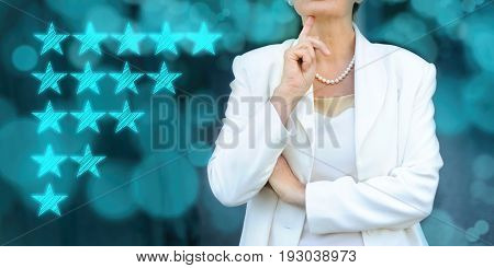 Quality performance review evaluation and classification ranking concept. Senior businesswoman silhouette in bacground.