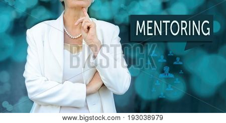 Mentoring and human resources concept. Senior leader (businesswoman manager) stands next to the chat bubble with text mentoring.