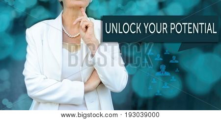 Coaching and human development concept. leader (businesswoman manager) stands next to the banner with text UNLOCK YOUR POTENTIAL.