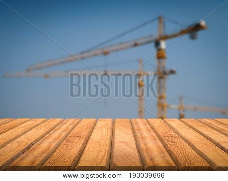 3d rendering wood floor with construction crane background