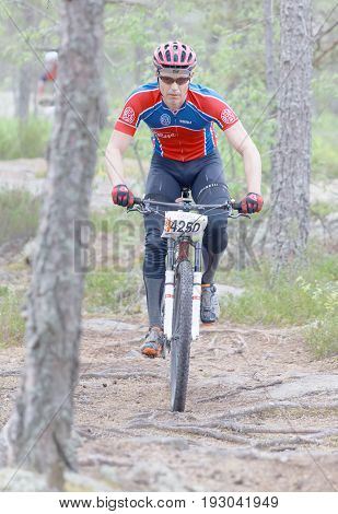 STOCKHOLM SWEDEN - JUNE 11 2017: Mountain bike cyclist in the forest at Lida Loop Mountain bike Race. June 11 2017 in Stockholm Sweden