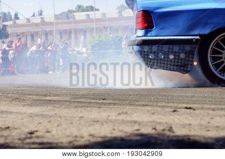 sport car wheel drifting and smoking on track