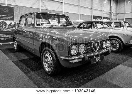 MAASTRICHT NETHERLANDS - JANUARY 15 2016: Compact executive car Alfa Romeo Giulia Nuova Super 1300 1975. Black and white. International Exhibition InterClassics & Topmobiel 2016