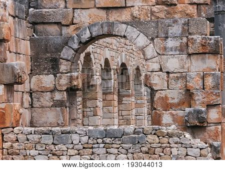 Stones and arches at Roman City ruins of Volubilis