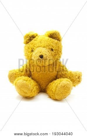Yellow teddy bear on a white background