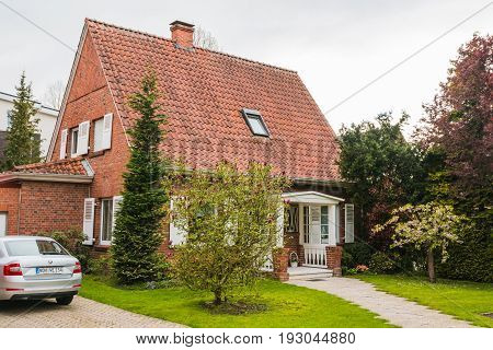 Beautiful House Is In A Small Street In Spring Day In Bad Benthe