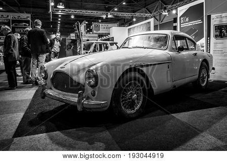 MAASTRICHT NETHERLANDS - JANUARY 15 2016: Rusty sports car Aston Martin DB Mark III. Black and white. International Exhibition InterClassics & Topmobiel 2016