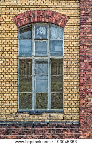 WINDOW - Brick facade of an old building