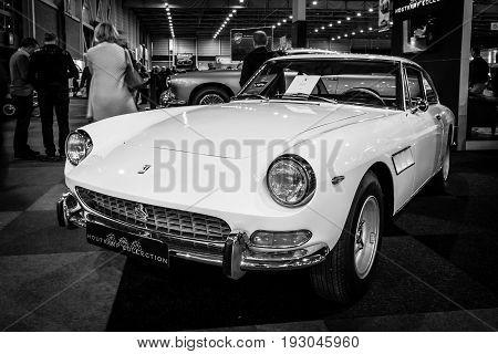 MAASTRICHT NETHERLANDS - JANUARY 15 2016: Sports car Ferrari 330 GT 2+2 1966. The body of the car designer Tom Tjaarda at Pininfarina. Black and white. International Exhibition InterClassics & Topmobiel 2016