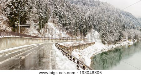 winter landscape with road along Tadami River in Fukushima Japan Panorama