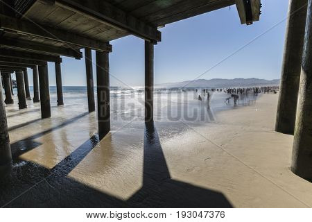 Santa Monica, California, USA - June 26, 2017:  Santa Monica beach with motion blur water and people.