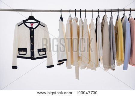female clothes of different coat on hangers