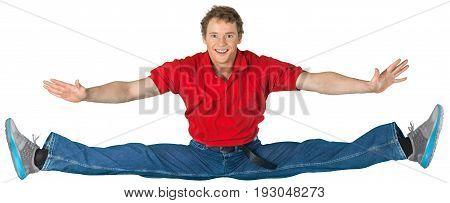 Young man jumping leg split leg split arms outstretched