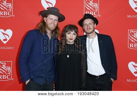 NEW YORK-JUN 26: Wesley Schultz, Neyla Pekarek and Jeremiah Fraites of The Lumineers attend the 13th Annual MusiCares MAP Fund Benefit Concert at PlayStation Theater on June 26, 2017 in New York City.