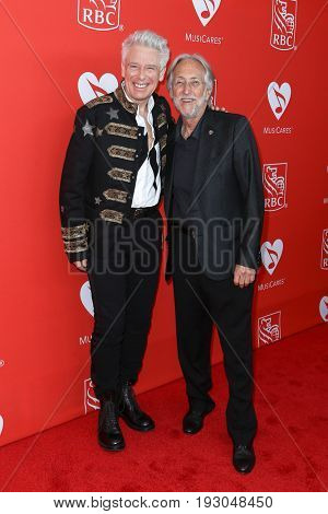 NEW YORK-JUN 26: Adam Clayton (L) and Neil Portnow attend the 13th Annual MusiCares MAP Fund Benefit Concert at PlayStation Theater on June 26, 2017 in New York City.
