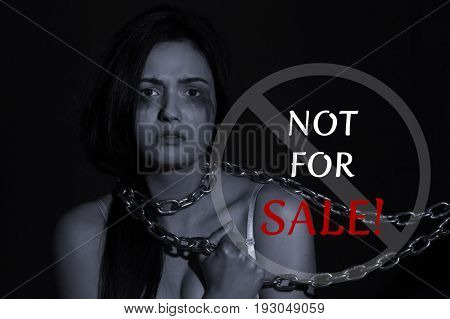 Concept of human trafficking. Text NOT FOR SALE and woman with chained neck on black background