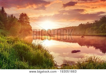 Landscape with sunset on the lake. Matutinal picturesque morning sky clouds in water sunbeam forest.