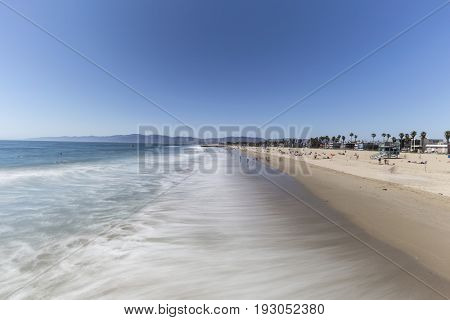 Venice Beach with motion blur water in Los Angeles, California.