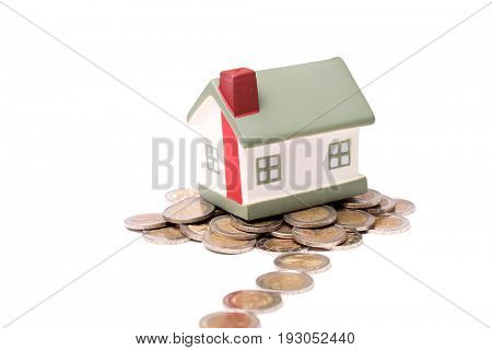 small house and coins, concept, isolated on white background